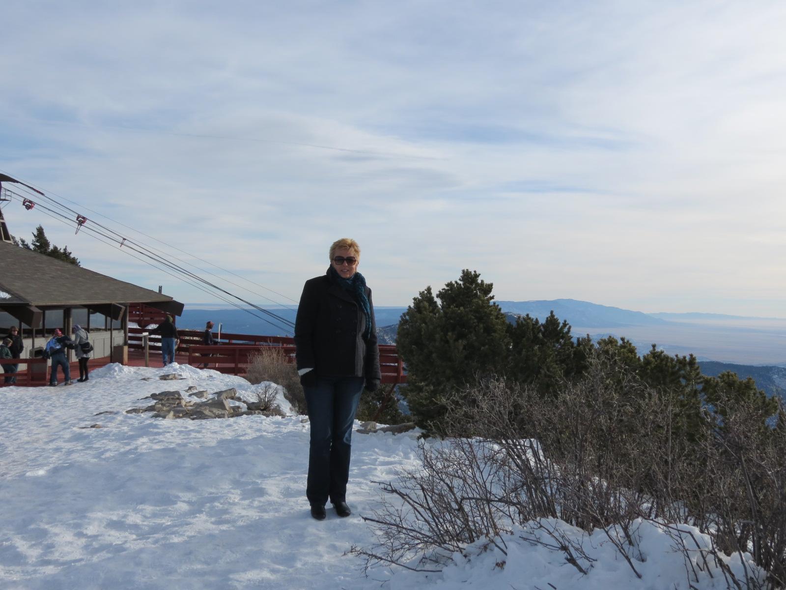 Carol freezing on top of Sandia Mountain