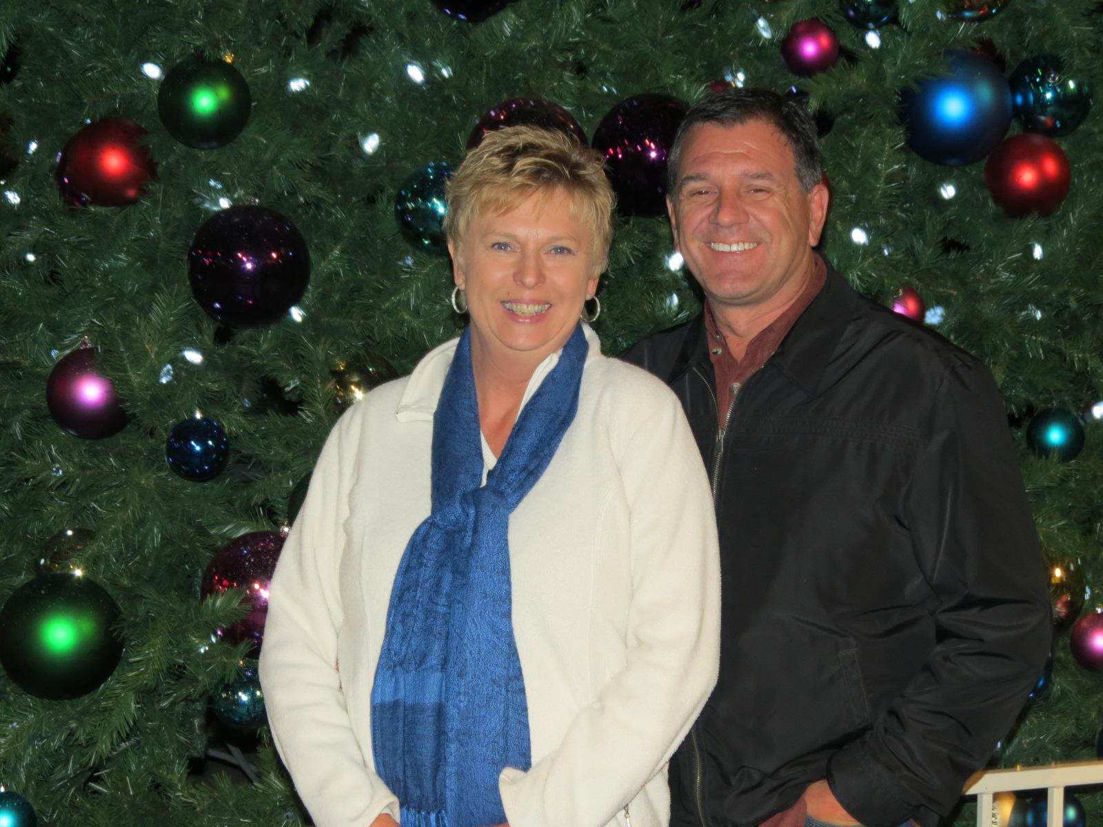 Lee & Carol in front of Christmas Tree