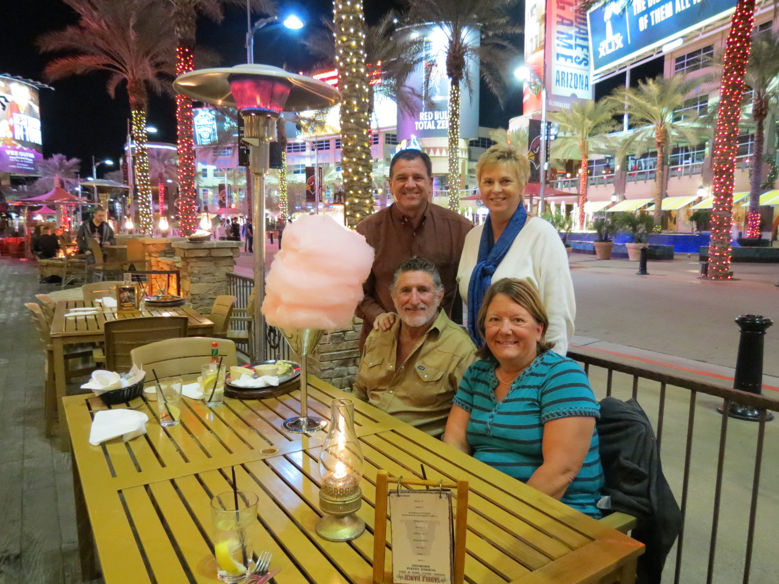 Vance, Donna, Lee & Carol at Saddle Ranch having a cotton candy tower after dinner.